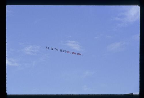 A sky banner congratulating Greg Norman on his victory at The Open Championship at Royal St Georges