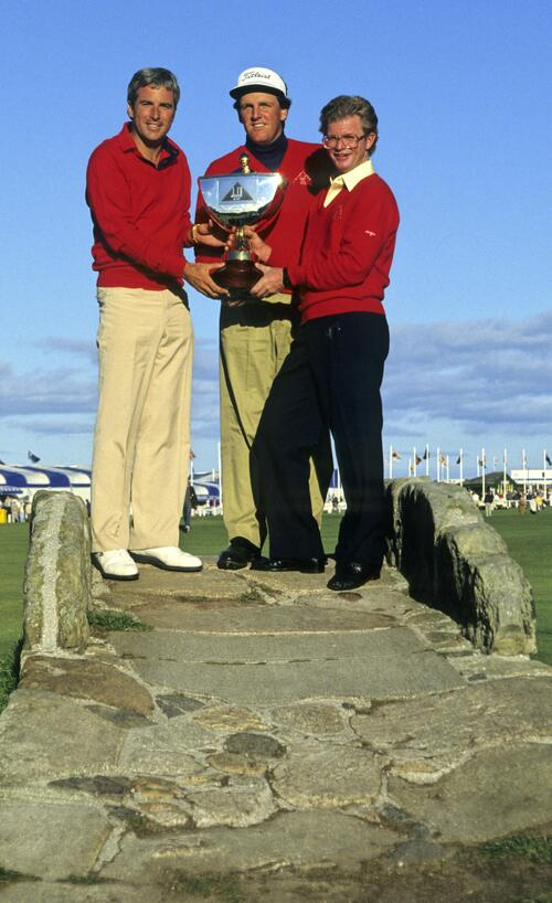 A victorious American team on Curtis Strange, Mark Calcavecchia and Tom Kite stand on the Swilcan Bridge with the Dunhill Cup at St Andrews