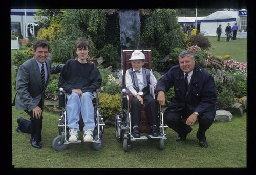 Peter Alliss with two of the 1993 Powered Sheelchair recipients at the Volvo British PGA Championship