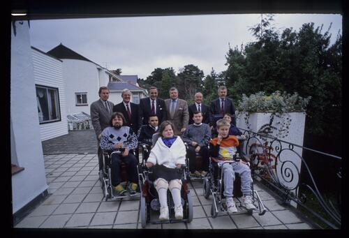 The 1992 recipients of powered wheelchairs pose with Peter Alliss at the Volvo British PGA Championship