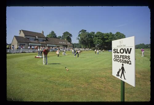 Golfers on the practice green before play at the Volvo British PGA Championship