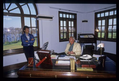 Arnold Palmer at work in his office