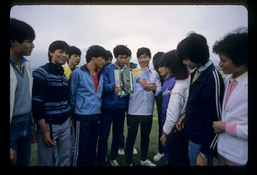 A group of young Chinese examine a copy of 'Golf World' magazine at the new Chung Shan Hot Spring Golf Club