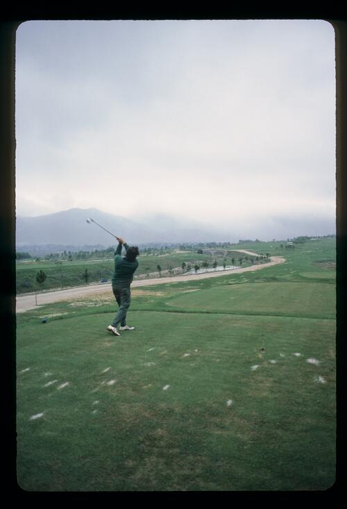 Golf photographer Lawrence Levy on the tee at the first golf course in Modern China