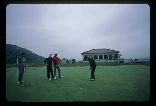 Golfer Lawrence Levy just misses his putt at China's Chung Shan Hot Spring Golf Club