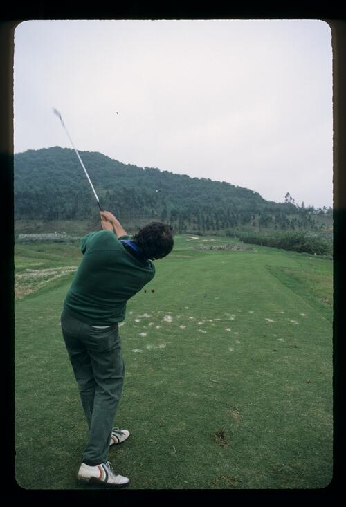 Lwarence Levy, golf photographer, tees off with his iron at the Chung Shan Hot Spring Golf Club