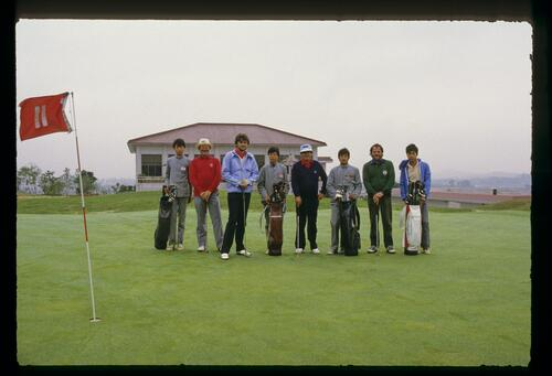 Lawrenec Levy, second from the right, poses with his group of golfers and caddies on the 11th green