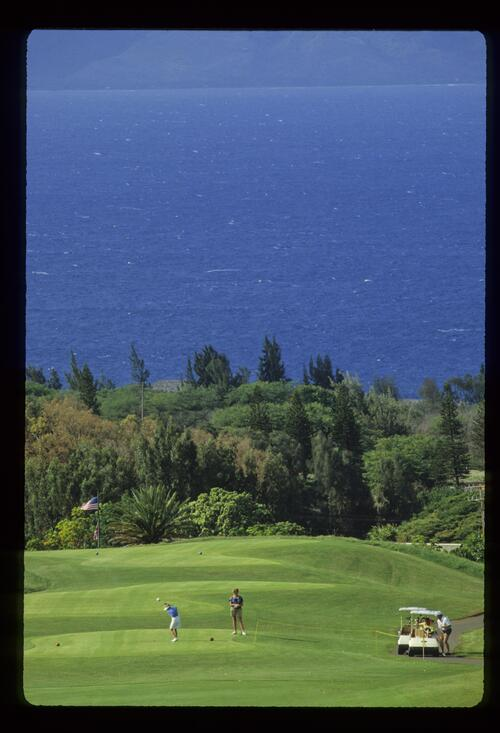 A scenic view of women playing the course at Kapalua Resort