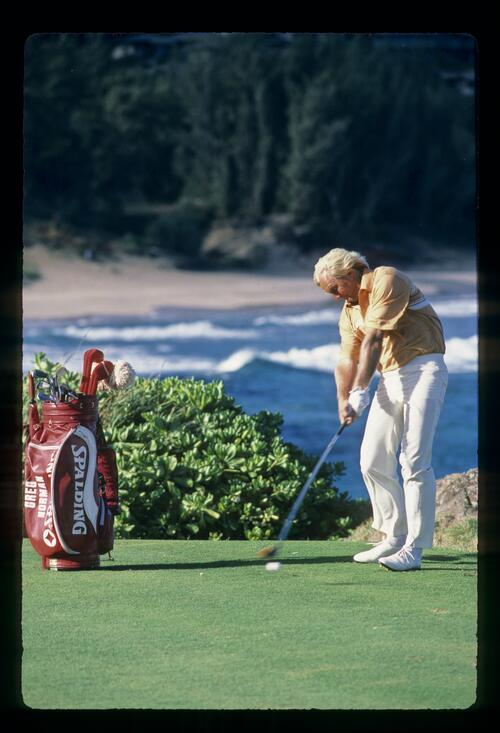 Greg Norman drives off of the tee at the 1984 Kapalua International Golf Championship