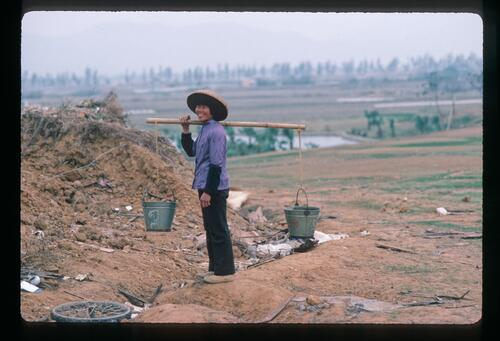 A Chinese labourer at the first golf course construction in Modern China at the Chung Shan Hot Spring Golf Club