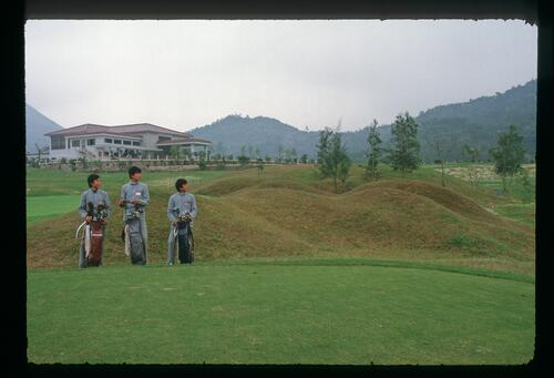 Caddies ready for play on the new Chung Shan Hot Spring Golf Club course in Modern China