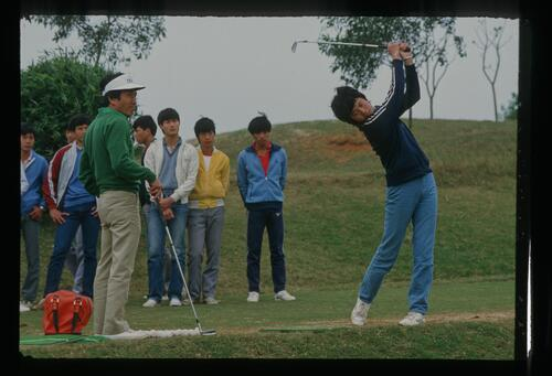 Young Chinese players on the practice tee at the new Chung Shan Hot Spring Golf Course