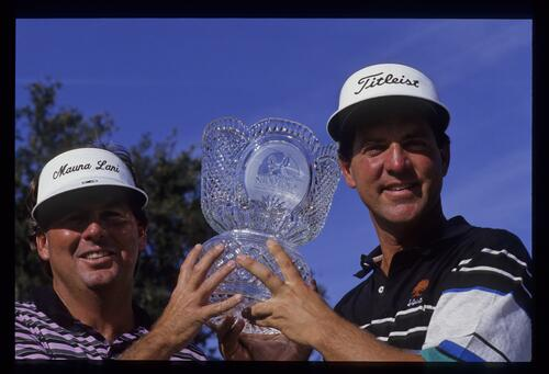 Winners Lanny Wadkins and Tom Purtzer lift the trophy at the 1991 Shark Shootout Golf Tournament