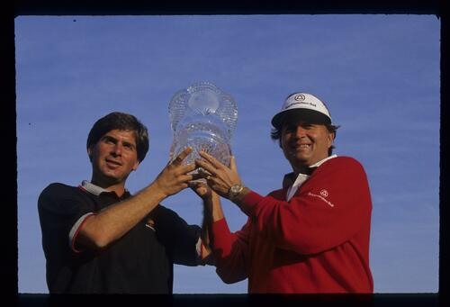 Fred Couples and Ray Floyd lift the trophy at the Ronald McDonald Children's Charity Golf Tournament