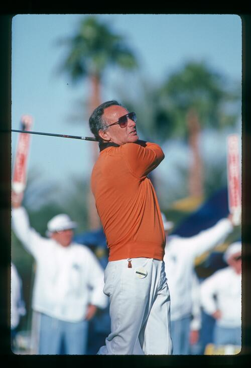Comedian Joey Bishop tees off at the 1982 Bob Hope Desert Classic Championship