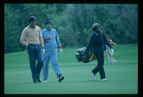 Golfers Seve Ballesteros and Ray Floyd brave the rain to play the Bay Hill Classic Championship