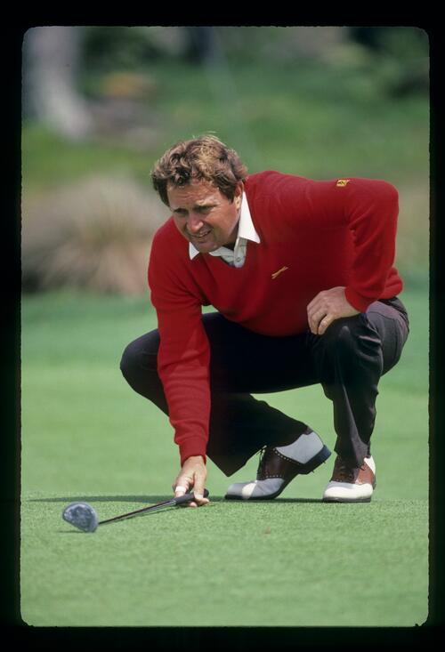Ray Floyd lines up his putt at The Players Championship at Sawgrass
