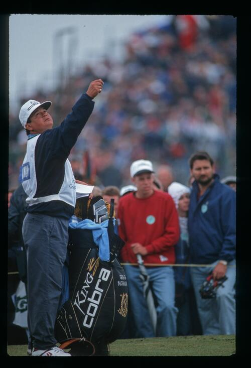 Greg Norman's caddie checks the wind at the 1993 Open Championship