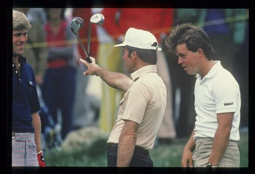 Golfer Gary Player demonstrates his grip strength to fellow golfer Hal Sutton