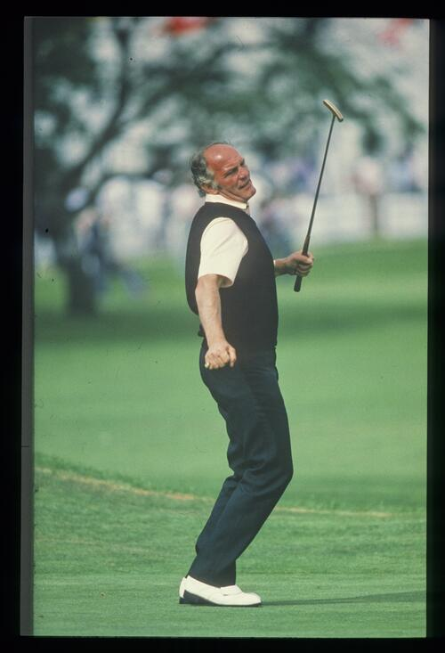 Ex-boxer Henry Cooper just misses his putt at the Four Stars Charity Golf Tournament