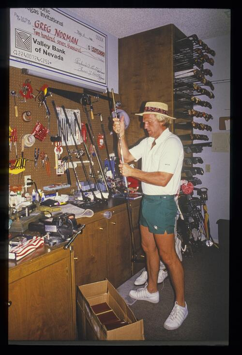 Greg Norman works on his clubs in his workshop