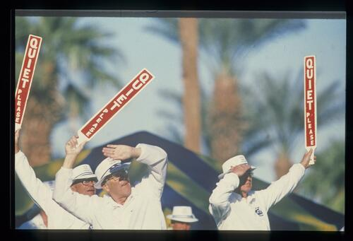 Marshals raise the 'Quiet Please' signs while they concentrate on the action at the Bob Hope Desert Classic Championship