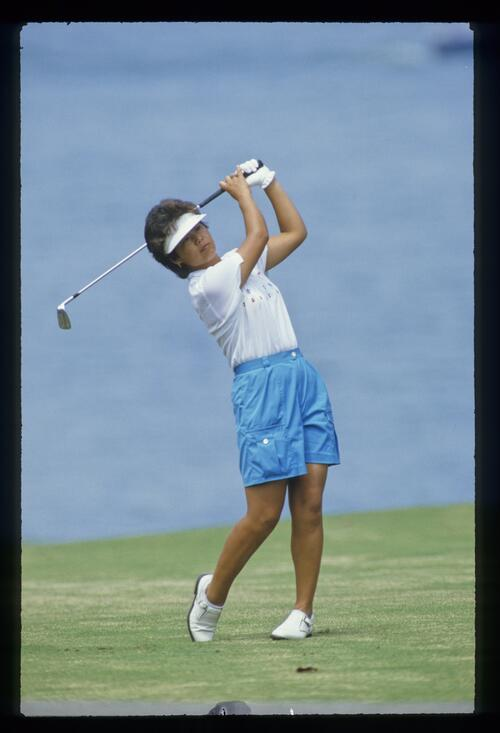 Ayako Okamoto closely watches her iron shot on her way to victory at the Ladies World Cup Championship in Japan