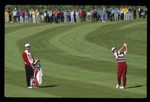 American golfer Tom Kite plays his iron from the fairway at the 1989 Ryder Cup