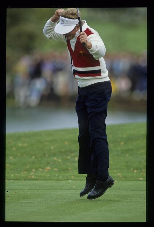 American Tom Kite leaps for joy as he claims a stunning victory of 8 and 7 over Europe's Howard Clark at the 1989 Ryder Cup