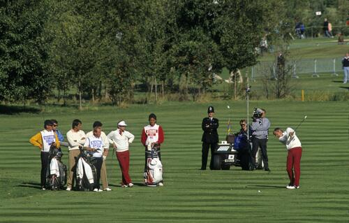 American golfer Curtis Strange plays his fairway shot in a tight match against Europe's Seve Ballesteros and Jose Maria Olazabal at the 1989 Ryder Cup