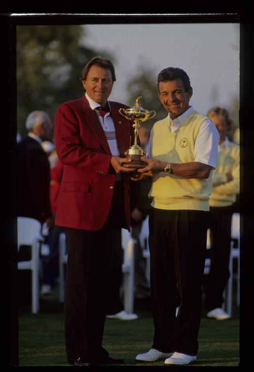 The opposing captains Ray Floyd and Tony Jacklin pose with the Ryder Cup at The Belfry