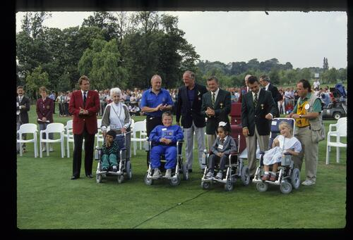 The new recipients of powered wheelchairs at the 1989 Ryder Cup