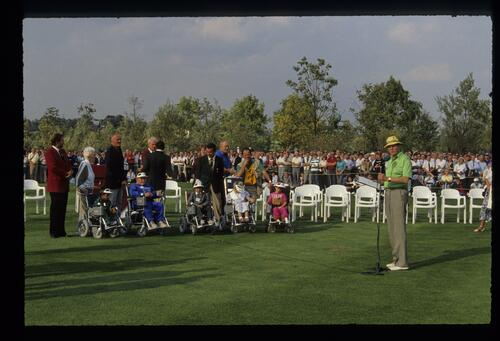 The presentation of new powered wheelchairs to young reicipients at the 1989 Ryder Cup