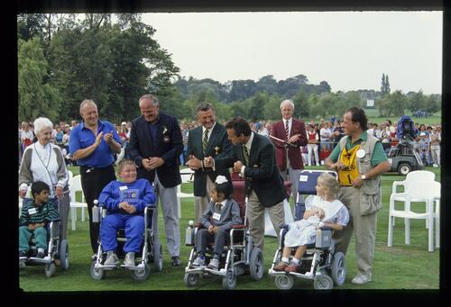 The latest recipients of powered wheelchairs at the 1989 Ryder Cup