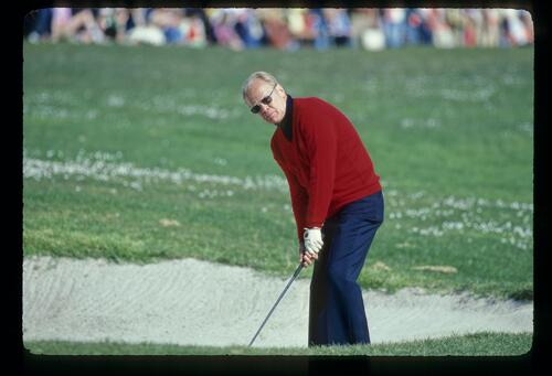 President Gerald Ford prepares to play his shot from the greenside bunker at the Bing Crosby Pro-Am Golf Championship
