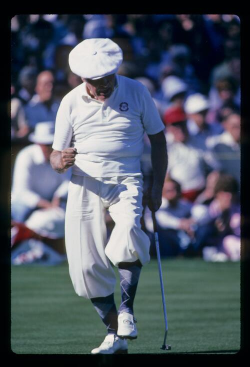 Actor and tournament sponsor Bob Hope, wearing his white Plus-Fours, holes his putt at the Bob Hope Desert Classic Golf Tournament