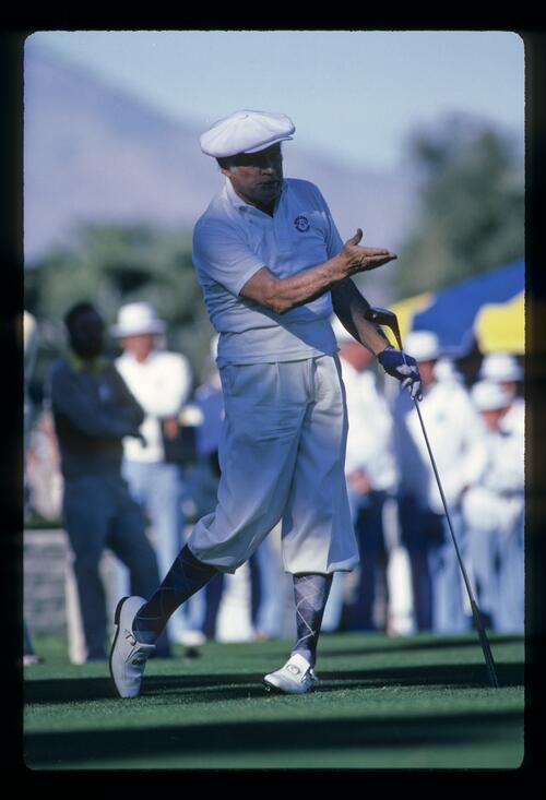 Actor Bob Hope directs his ball from the tee at the Bob Hope Desert Classic Golf Tournament