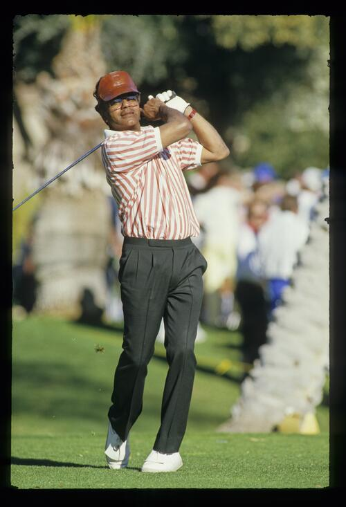 Singer Johnny Mathis tees off at the 1987 Bob Hope Chrysler Classic Golf Championship