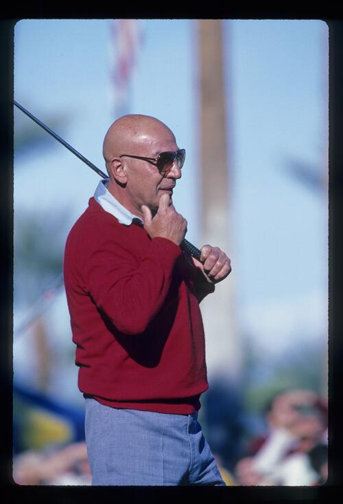 American actor Telly Savalas considers his next shot at the Bob Hope Desert Classic Golf Championship