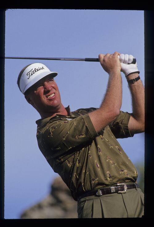 Golfer Steve Elkington plays his way to victory with teammate Ray Floyd at the 1993 Shark Shootout Golf Tournament