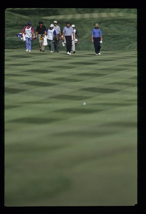 An artistic view of golfers Greg Norman, Nick Price and Tom Kite walking the fairway at the 1993 Shark Shootout