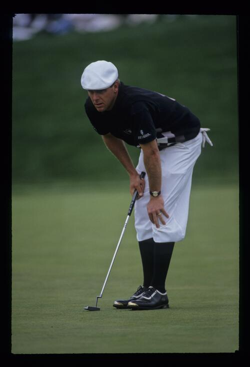Golfer Payne Stewart surveys his putt at the 1993 Shark Shootout