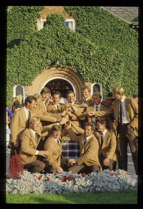 The victorious 1985 European Ryder Cup team pose for photos with the trophy at The Belfry