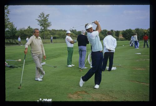 European golfer Sandy Lyle on the practice tees with coach Bob Torrance at the 1987 Ryder Cup