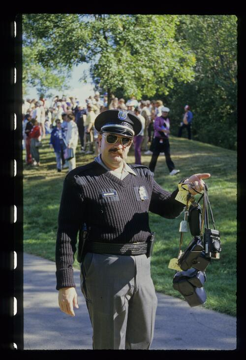 A Police Officer exhibits confiscated cameras at the 1987 Ryder Cup