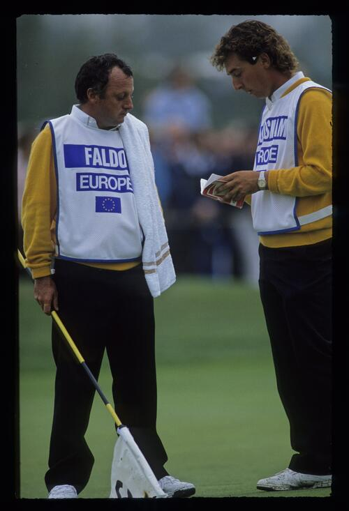 Nick Faldo's caddie checks yardage with Ian Woosnam's caddie at the 1989 Ryder Cup at The Belfry