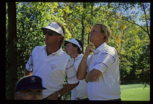 The United States team captain Jack Nicklaus closely watches the action with players Payne Stewart and Larry Mize at the 1987 Ryder Cup