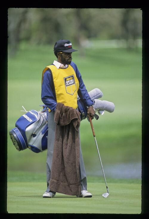 A caddie waits patiently for his golfer at the 1988 Bay Hill Classic