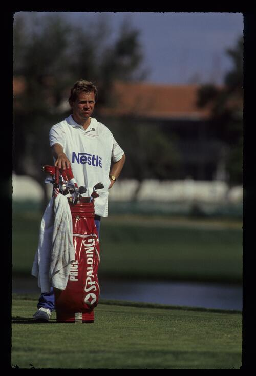 The caddie of golfer Nick Price tends the bag at the 1990 Bay Hill Nestle Invitational