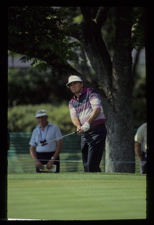 Golfer Ray Floyd plays his chip shot from the greenside rough at the Nestle Invitational at Bay Hill
